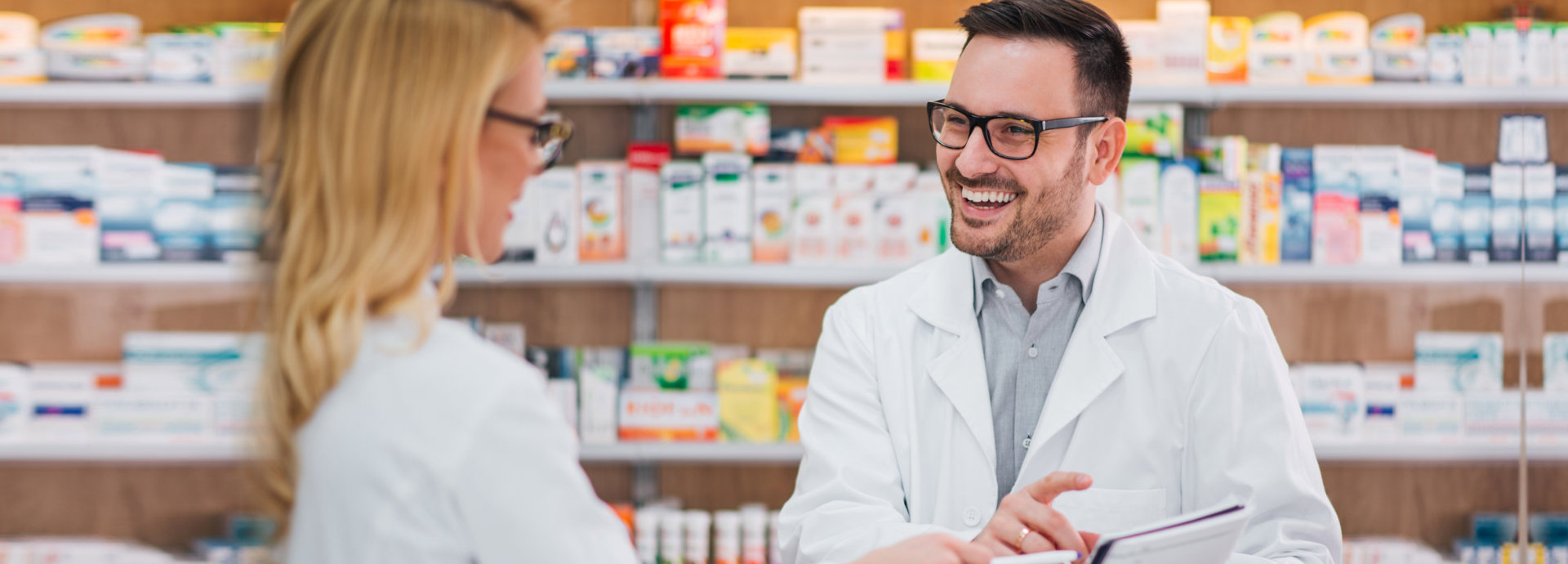 a pharmacist chatting with a lady