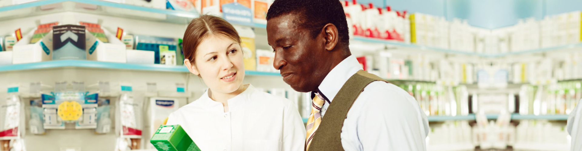 pharmacist chatting with a man